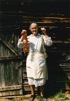 Nellie Kinsey holding a string of leather britches and red peppers, Kinsey Town,  White County, GA, 1989. Photo by Maggie Holtzberg
