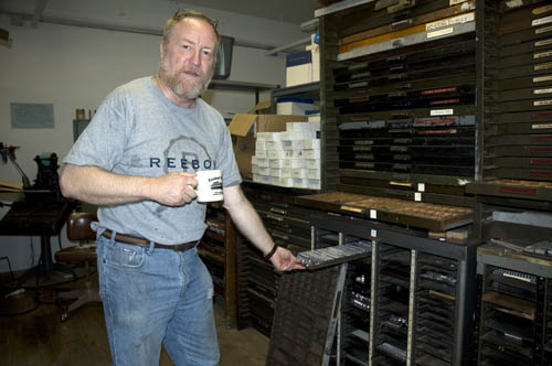 John Kristensen pulling out a galley of type at Firefly Press.