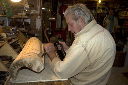 Cayoni working on an eagle mask. Photo by Maggie Holtzberg.