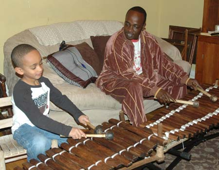Sekou and Balla Kouyate playing balafons