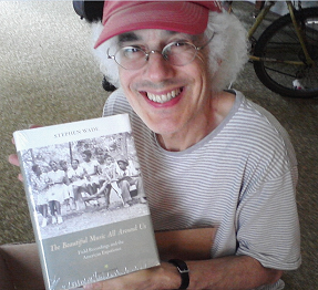 Stephen Wade holding a copy of his book