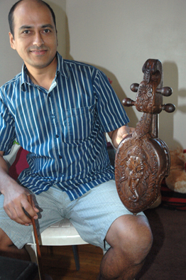 Sushil Gautam posing with Nepalese sarangi. Photo by Maggie Holtzberg