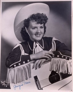 Georgia Mae Harp with her signature white guitar