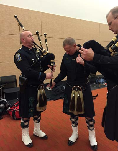 Boston Police Gaelic Column Pipe & Drum Band tuning up backstage