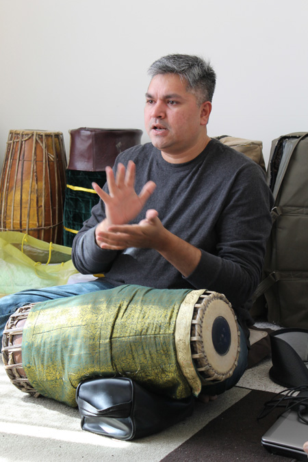 Gaurish Chandrashekhar teaching mridangum. Photo by Jennifer Atwood.