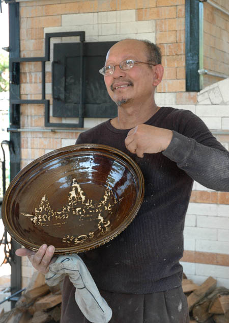 Yary holding brown bowl