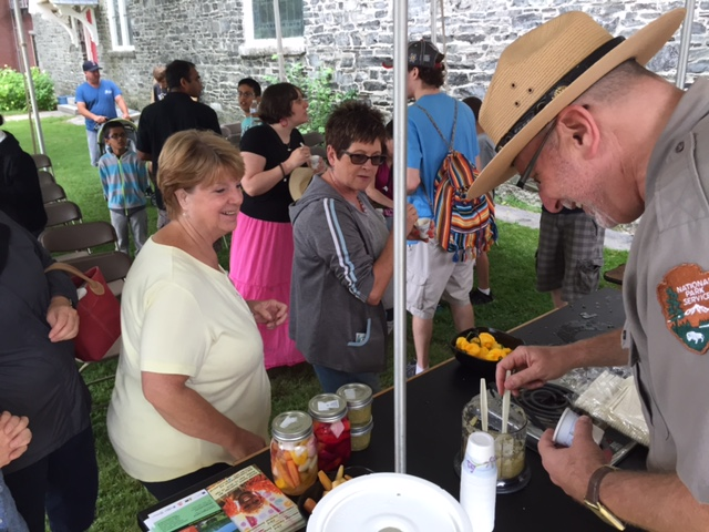David Blackburn serving pickes at the foodways demonstration tent