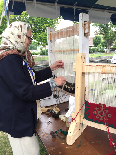 Fatima Vejzovic of Hartford demonstrating Bosnian rug weaving