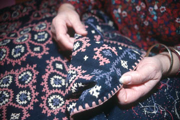 Anahid Kazazian inspecting Armenian Marash embroidery