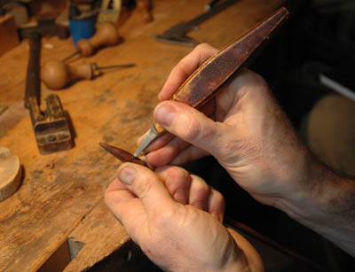 Violin bowmaker David Hawthorne chiseling mortise