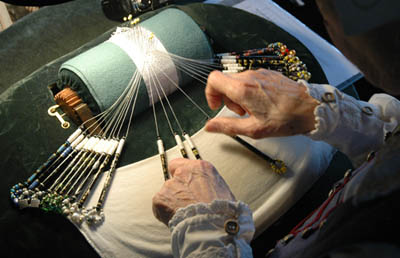 Linda Lane making bobbin lace