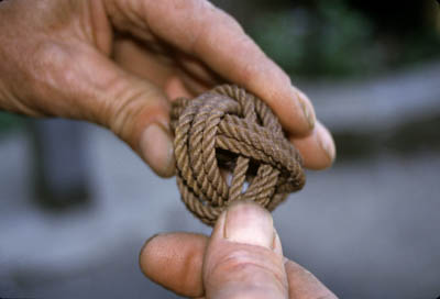 Fisherman Marco Randazzo holding one of his rope sculptures