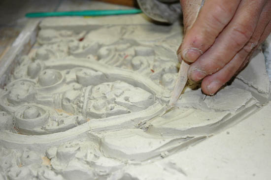 Cambodian ceramicist Yary Livan carving clay