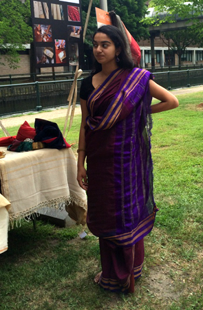 Jaya wearing a purple sari