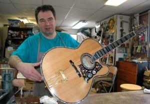 Pantazelos holding jazz guitar