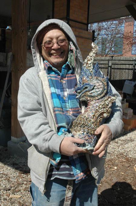 Yary holding naga