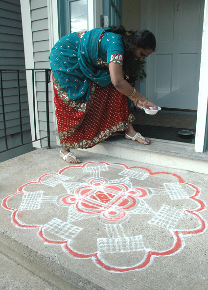 Priya working on kolam