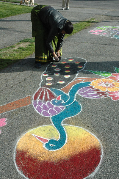 Sridevii working on peacock kolam