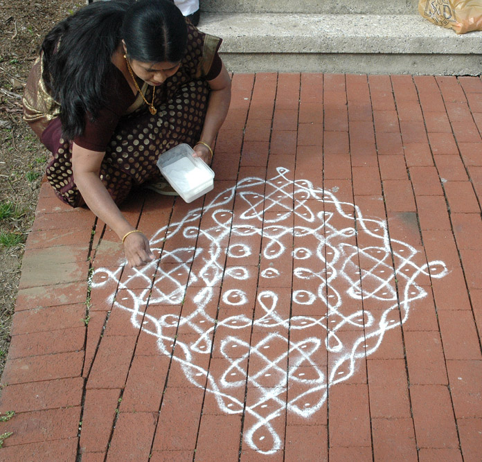 Geetha finishing up Sikku kolam