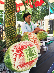 Ruben Arroco carving watermelon
